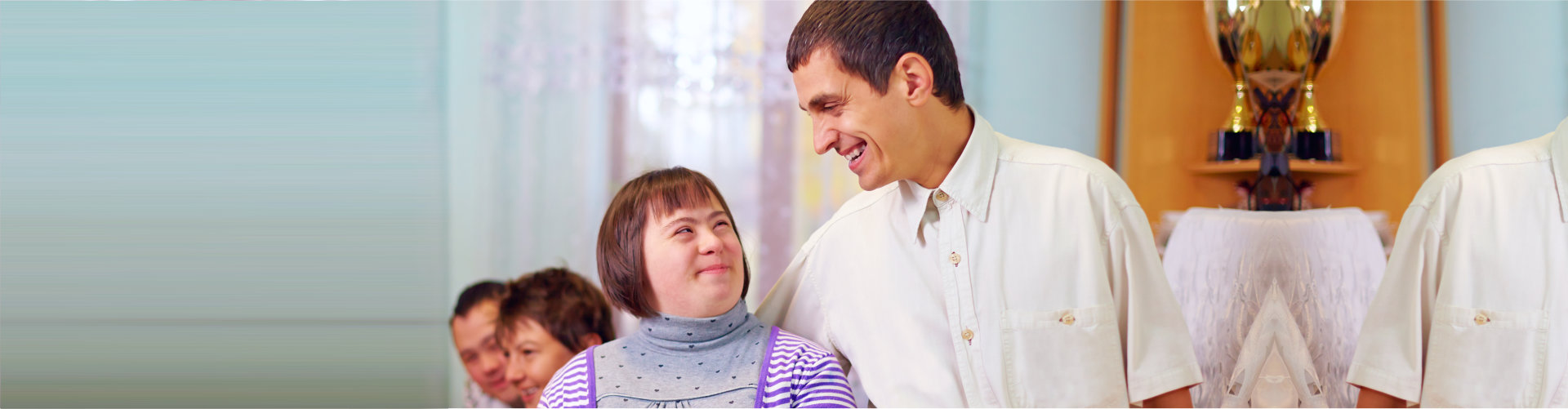 person with disablity smiling to each other